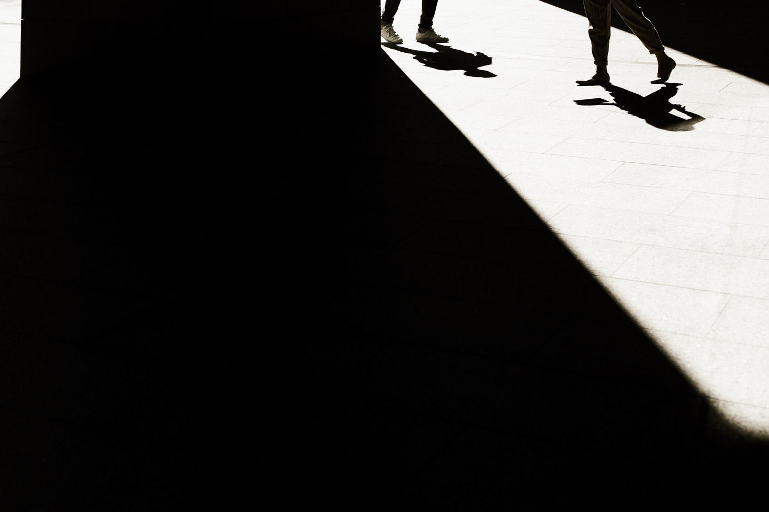 Black and white image of couple and shadows