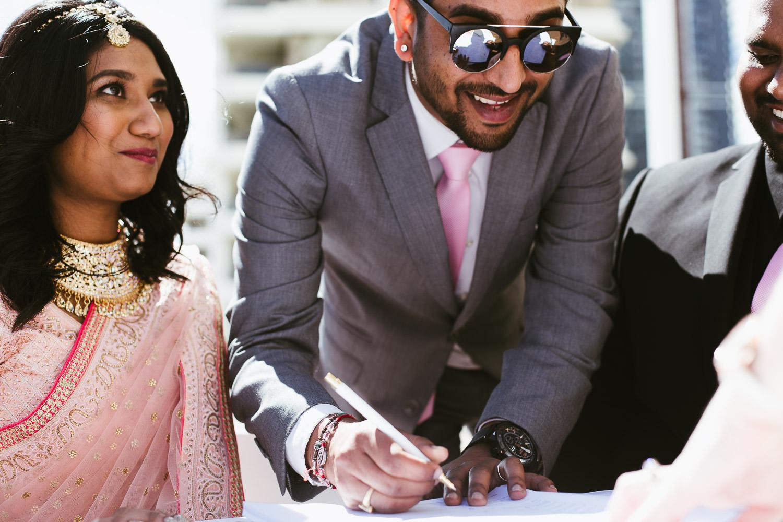 BEst man signing wedding documents