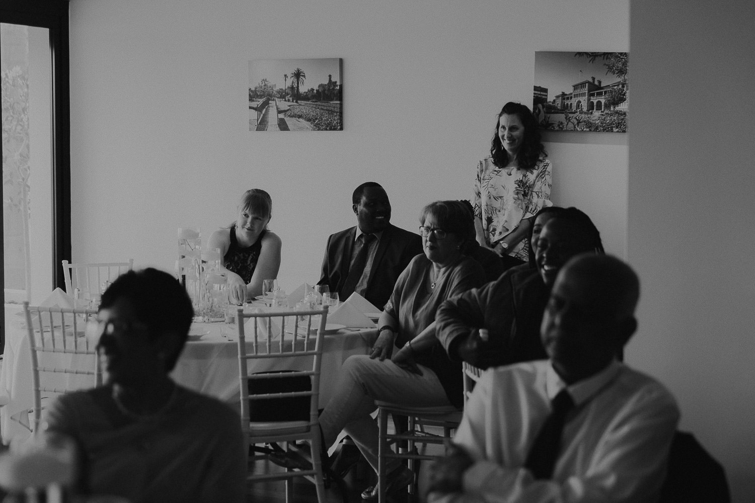 Guests watching on at wedding speeches