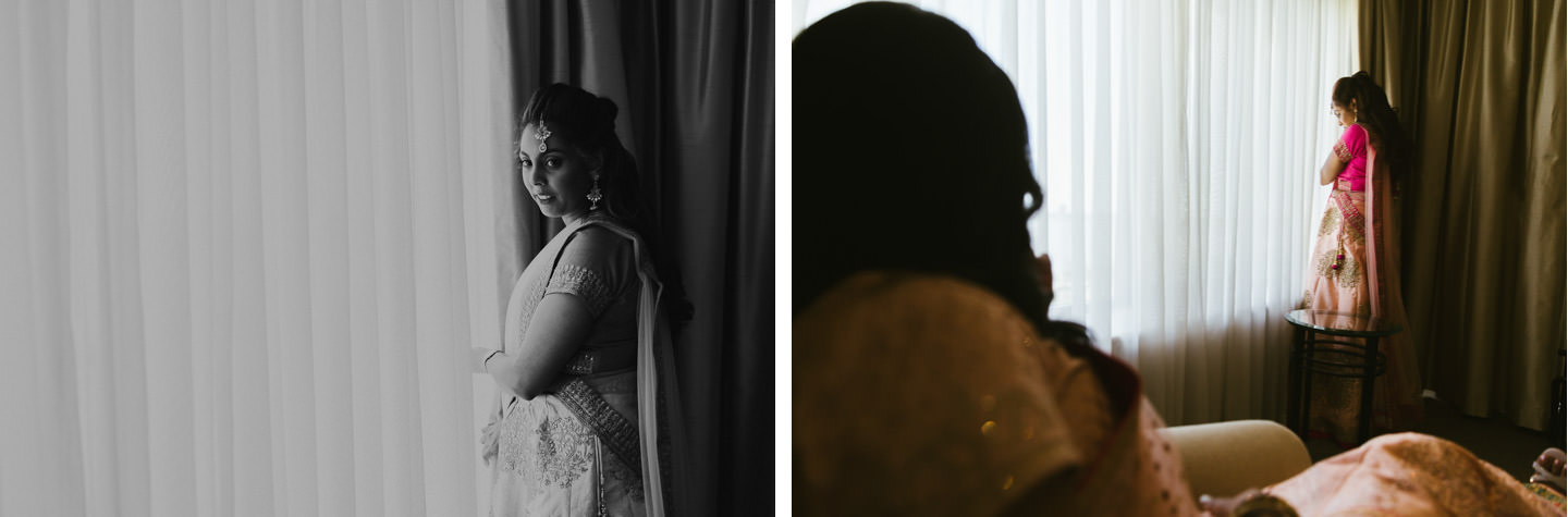 Maid of honour peeking down to the ceremony from hotel room at Crowne Plaza