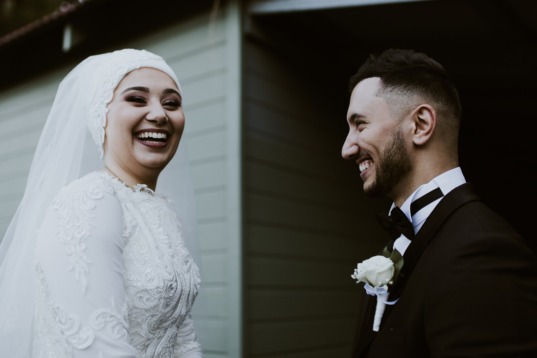 Bride and groom hacing a good laugh