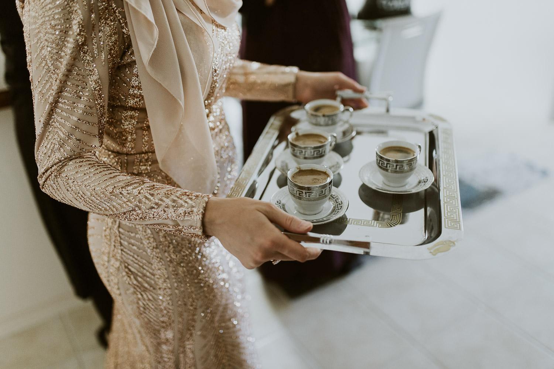 Sister in law serving tea to the elders