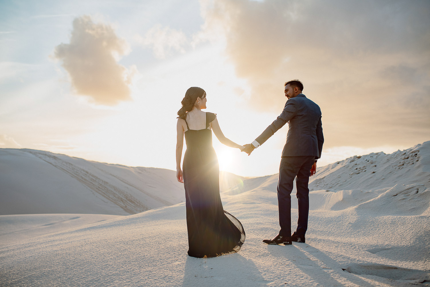 couple holding hands on lancelin sand dunes