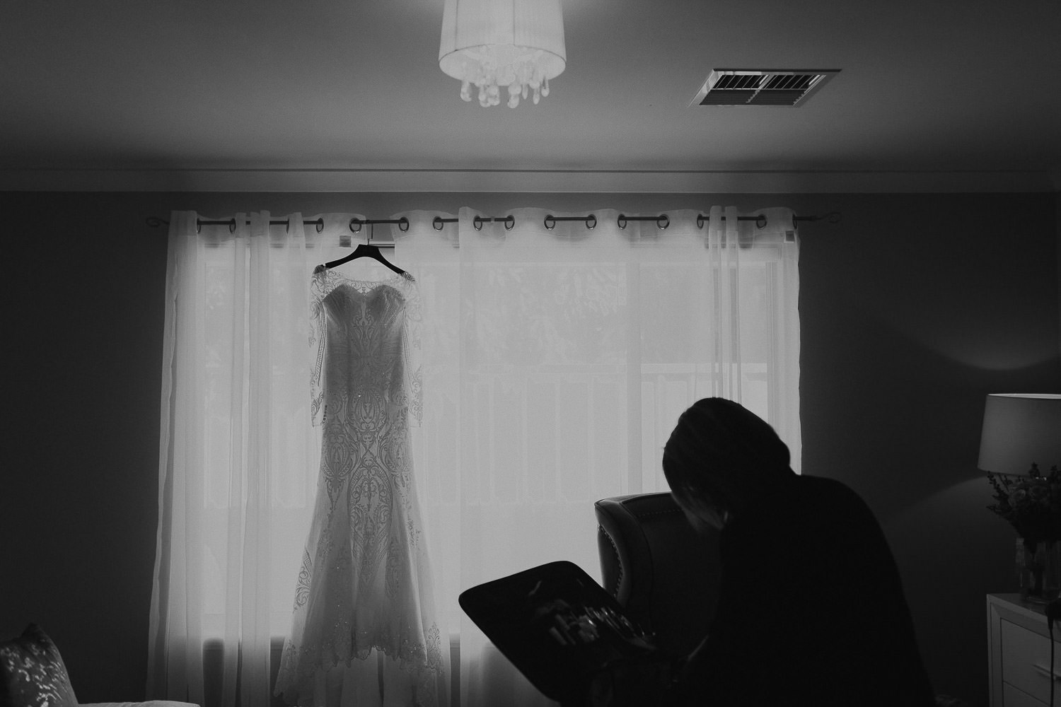 Black and white photo Fatimah Mohsin wedding dress in background