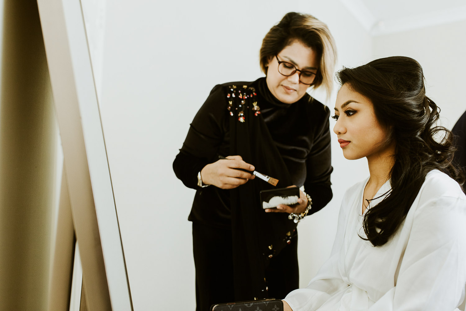 Fatimah Mohsin doing make up on the bride
