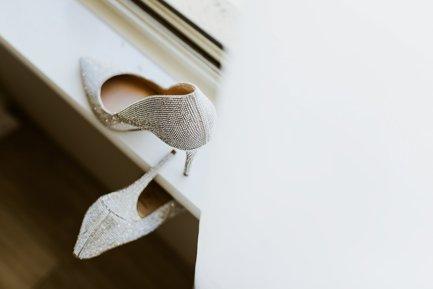 Brides diamonte wedding shoes on window sill