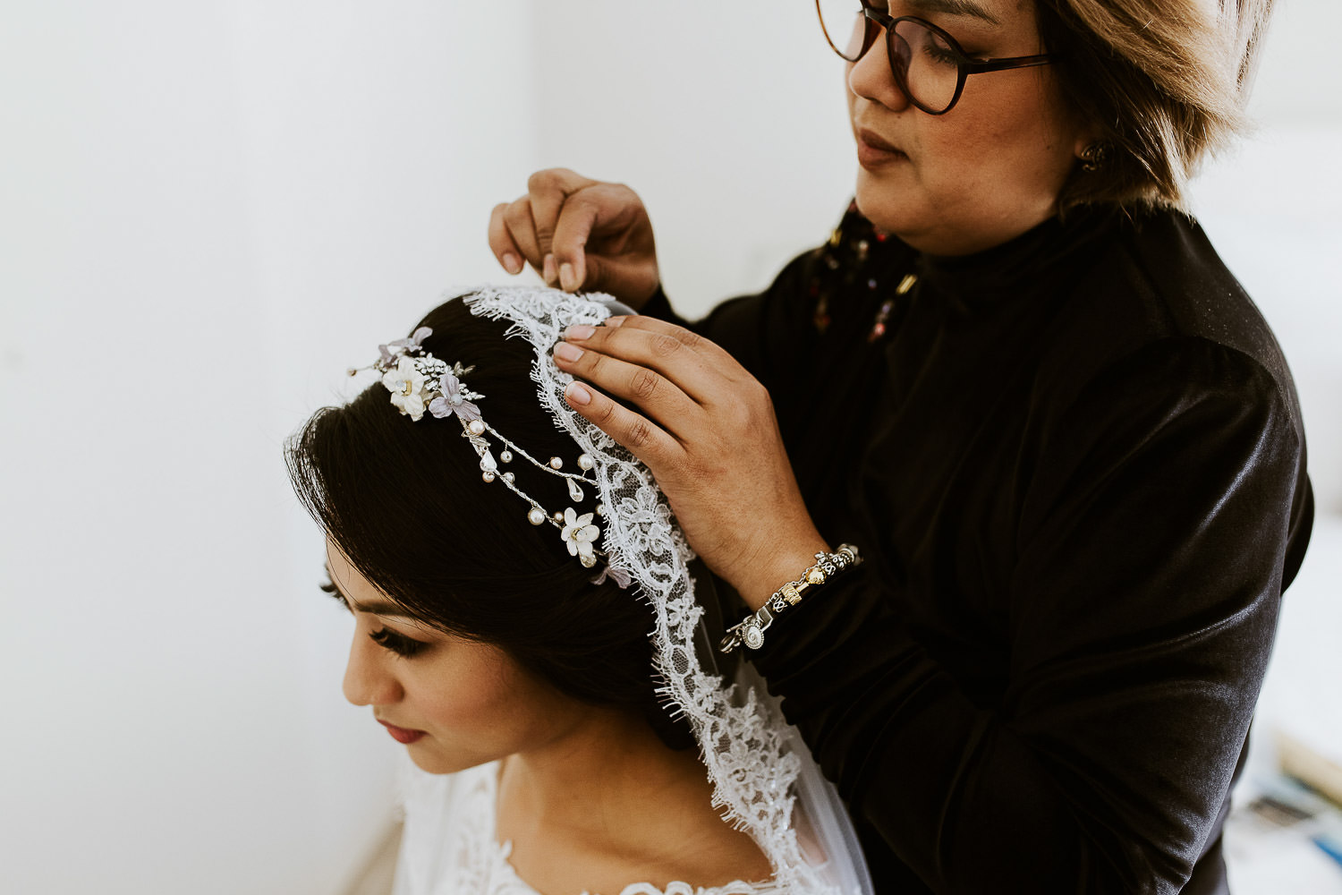 Fatimah Mohsin fitting veil on bride