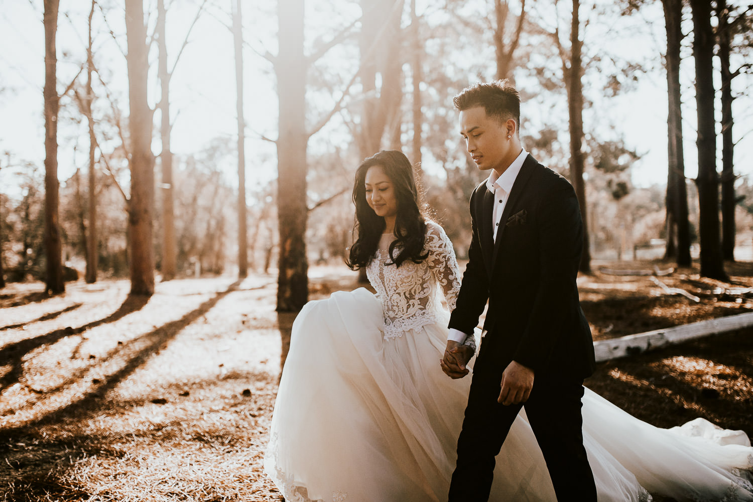 Wanneroo pines bride and groom walking hand in hand